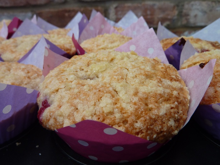 making mango and raspberry crumble muffins