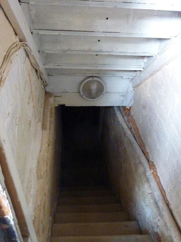 5-10-13 - E inspecting stairgate_cellar view 4B