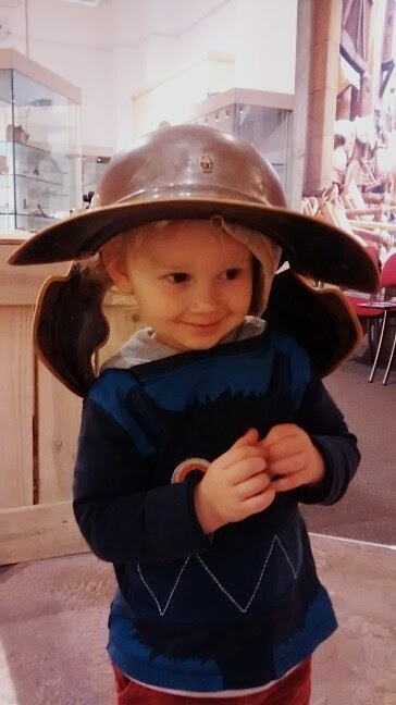 4 year old wearing Roman helmet at GLoucester Museum - nipitinthebud.co.uk