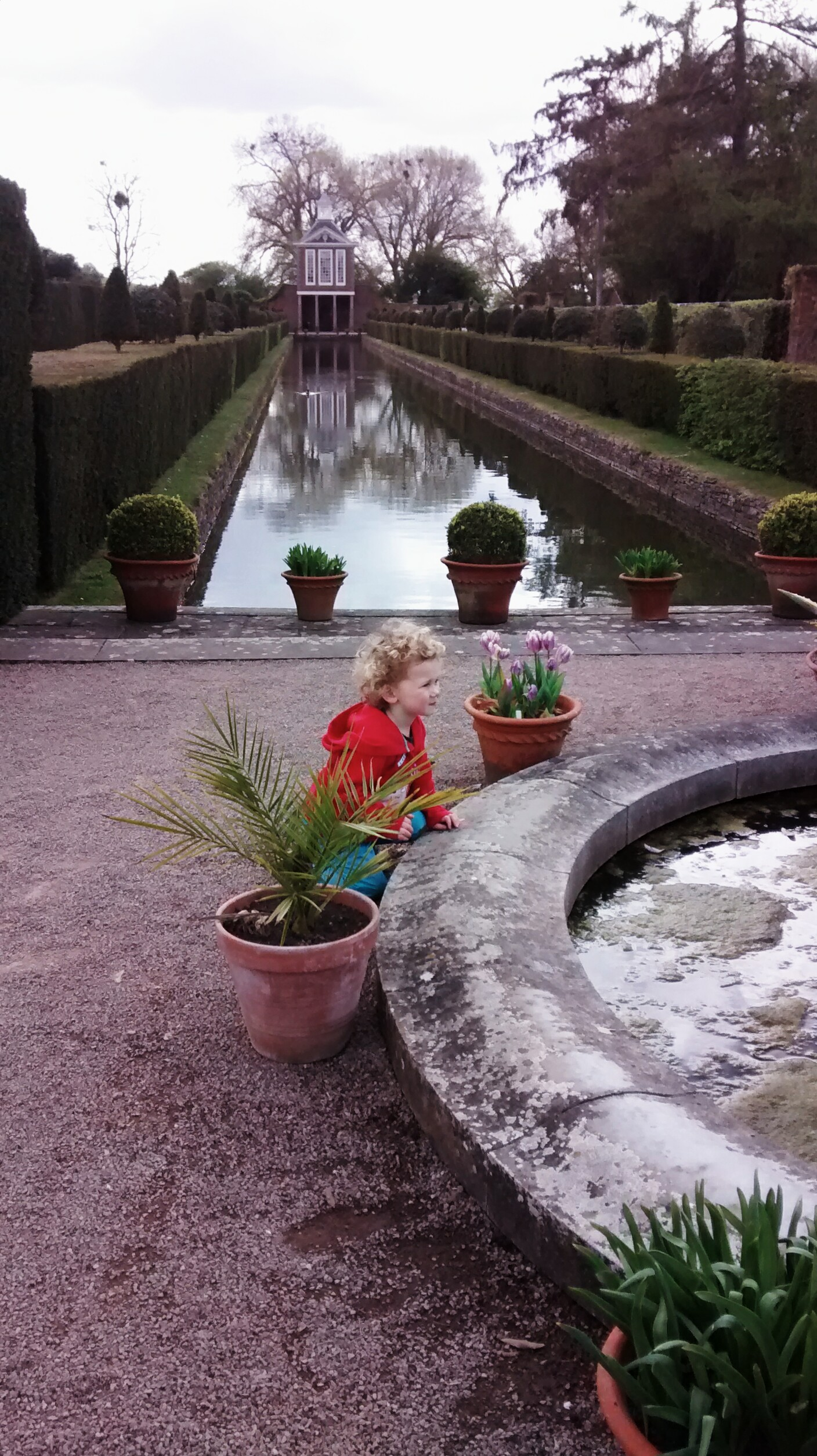 toddler by the fountain at Westbury Court National Trust Gardens
