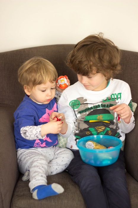 Easter Sunday egg hunt_brothers sharing eggs